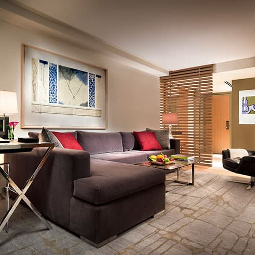Deluxe Suites feature 430 square-feet of a contemporary two-room layout, offering a separate living room and bedroom.