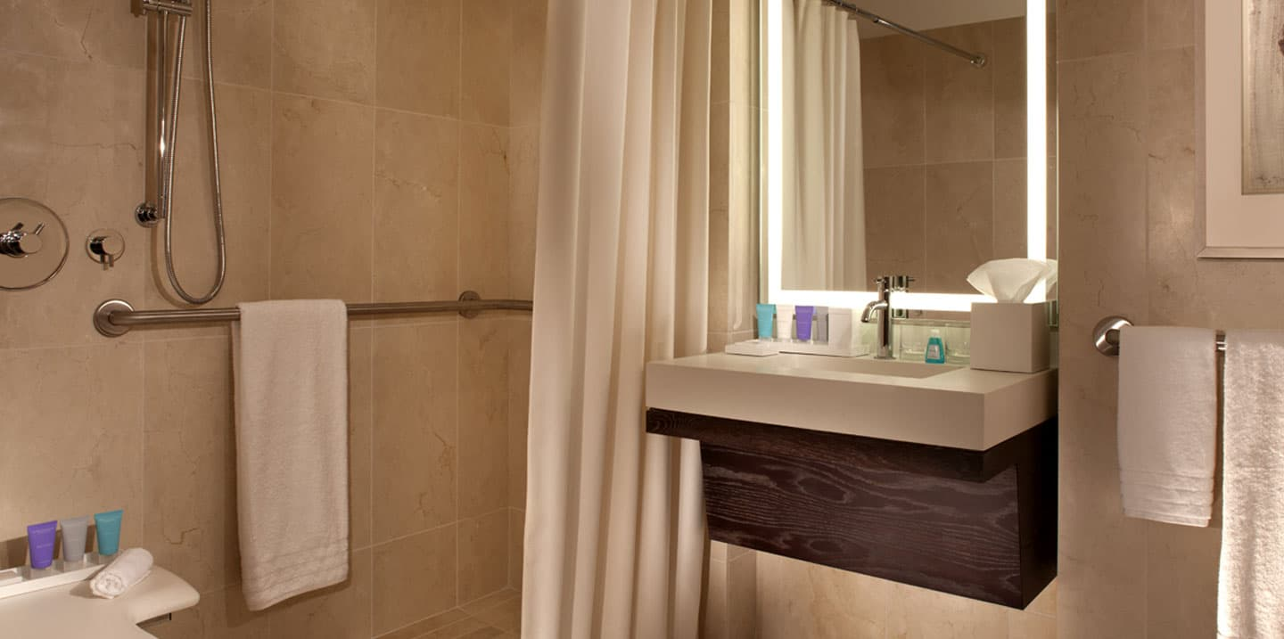 Deluxe suite hearing accessible with accessible tub for Ada accessible bathroom
